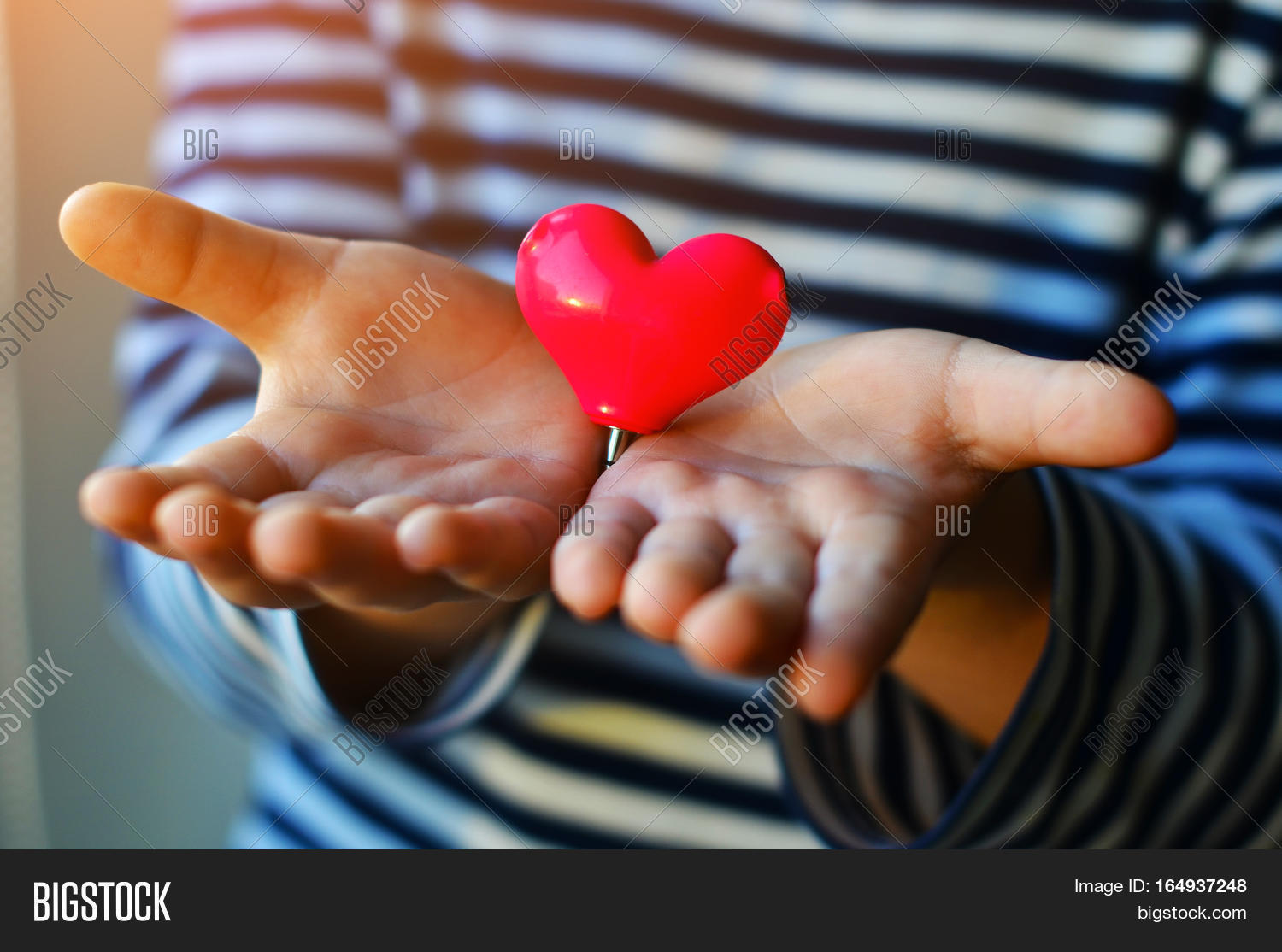 Child Holding Small Image Photo Free Trial Bigstock