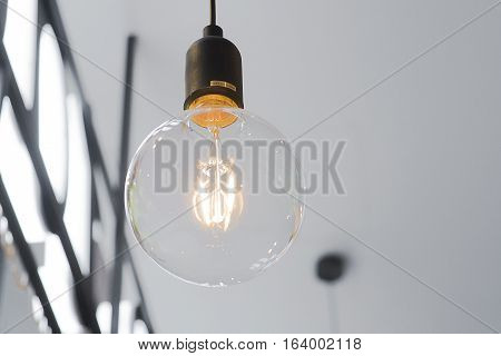 A beautiful incandescent lamp from under view.