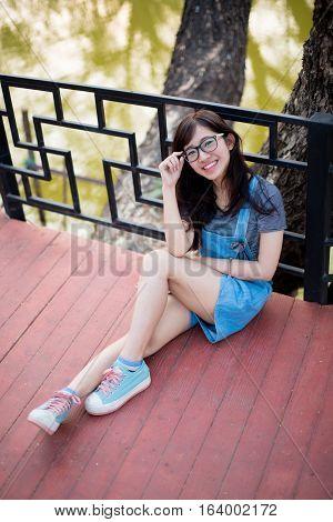 Portrait of a beautiful young woman wearing elegant glasses,Optics style.