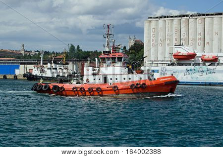 ISTANBUL TURKEY - JUNE 8 2016: Tug boat serving the Haydarpasa Port of Istanbul viewed from the sea on a sunny afternoon in June.