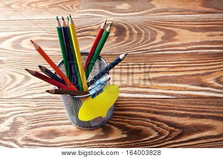 Stationery box with pencils and card. Business concept