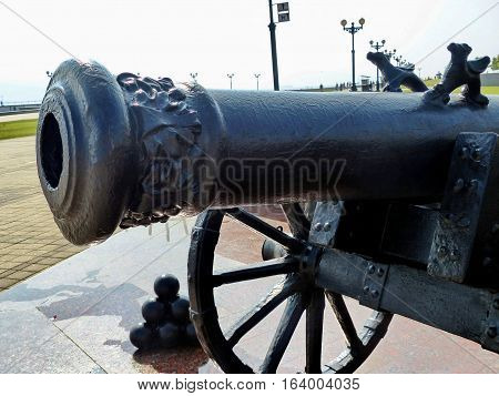 NOVOROSSIYSK, RUSSIA - August 10, 2016: Old cast-iron cannon of times of the Crimean War on the waterfront. Autumn. Closeup