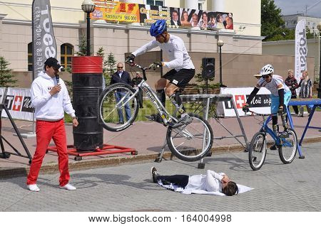 Timur Ibragimov and Mikhail Sukhanov's performance champions of Russia on a cycle trial. City Day of Tyumen on July 26, 2016. Tyumen, Russia