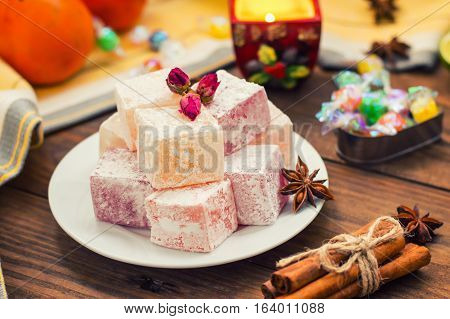 Delight, or Lokum - sweetness of sugar or flour, with addition of starch, and nuts. The most common Turkish Delight, which is now referred to simply as delight . Wooden background. Top view. Close-up poster