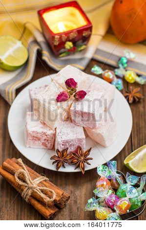 Delight, or Lokum - sweetness of sugar or flour, with addition of starch, and nuts. The most common Turkish Delight, which is now referred to simply as delight . Wooden background. Top view. Close-up
