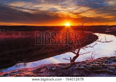 View from a bluff overlooking the Osage River during sunset with a colorful sunset