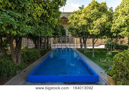small pool next to Tomb of Hafez poet in Shiraz city in Iran