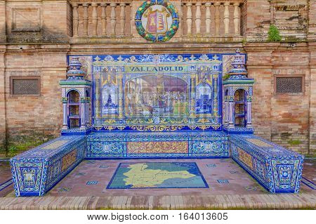 Seville, Spain - January 3, 2017:  Glazed tiles bench of spanish province of Valladolid at Plaza de Espana Seville Spain
