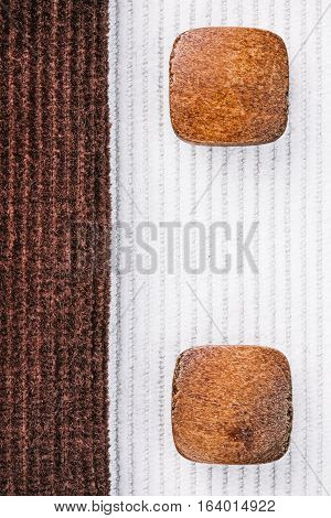 Milky white and chocolate brown corduroy combination with wood buttons. Macro view