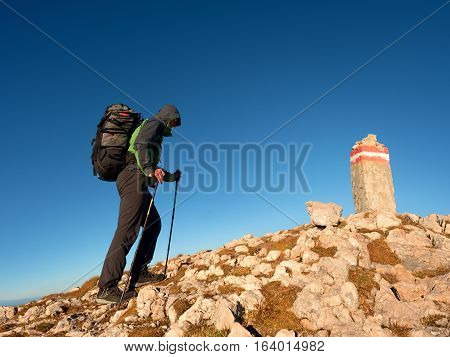 Tourist With Poles And  Backpack Walk To Mountain Peak. Last Step To Summit