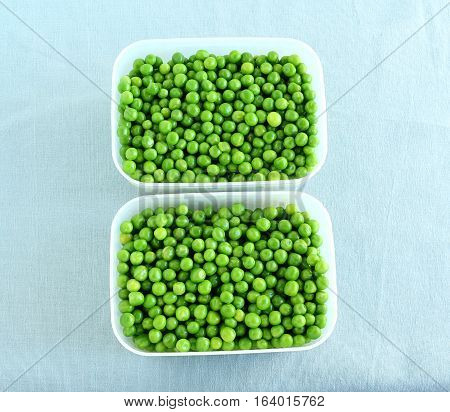 Healthy food cooked peas in two freezer safe boxes.