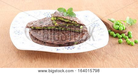 Healthy Indian food ragi paratha or bread made from finger millet flour and ground mixture of peas and other items.