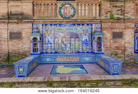 Seville, Spain - January 2, 2017: Glazed tiles bench of spanish province of Valladolid at Plaza de Espana Seville Spain