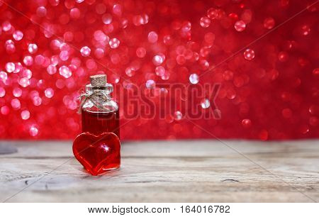 valentine's day bottle of love elixir transparent red heart on a wooden table