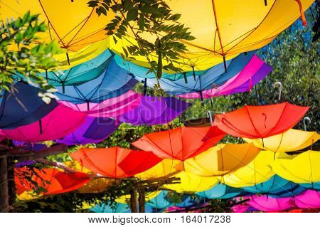Upturned bright and colorful umbrellas with sunlight