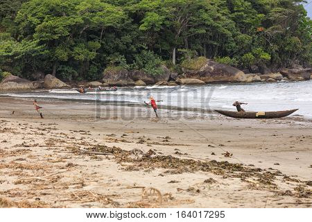 MAROANTSETRA MADAGASCAR OCTOBER 19.2016 Native malagasy peoples on beach pulling a fishing net from sea. Life of indigenous peoples in Madagascar countryside. October 19. 2016 Madagascar