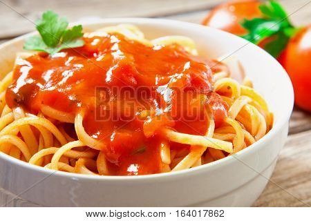 white bowl with homemade tomato sauce spaghetti