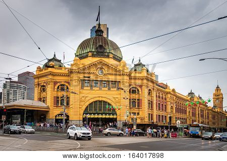 Melbourne, Australia - December 27 2016: Flinders Street railway station is situated on the corner of Flinders and Swanston Streets right in the centre of the city