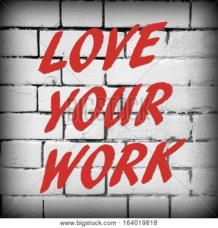 The words Love Your Work in red text on a white brick wall as a concept for job satisfaction.
