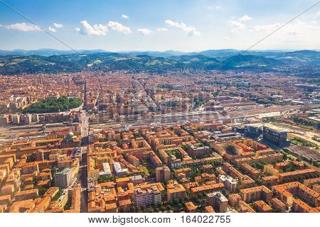 Cityscape of Bologna city, Italy, from aereal view. Famous landmarks: Central train station, the Two Towers, the Seven Churches.
