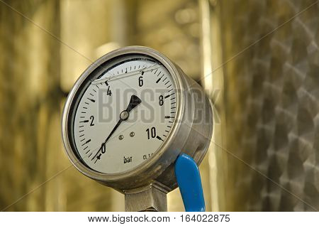 Close up of barometer mounted on industrial device