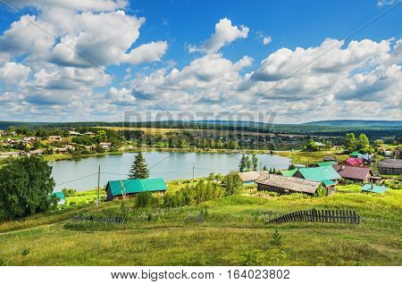 Summer rural landscape. Russia. Ural village Chusovoe founded in 1727 by Akinfy Demidov