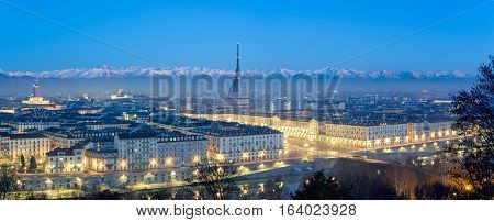 Turin high definition panorama at blue hour with the Mole Antonelliana and the snowy Alps in the background