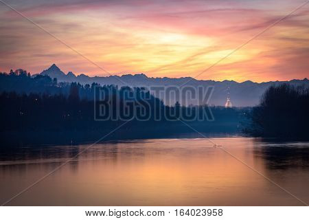 Turin amazing sunset with Mole Antonelliana river Po and Monviso