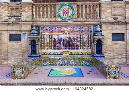 Seville, Spain - January 2, 2017: Glazed tiles bench of spanish province of Gerona at Plaza de Espana Seville Spain