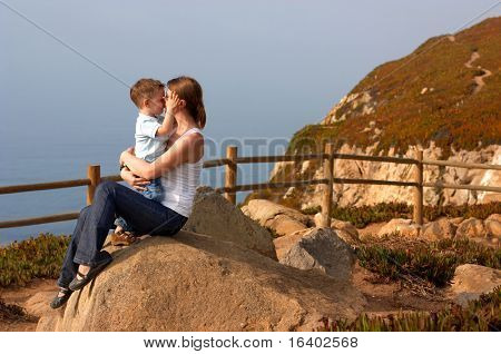 Loving moment between mother and son playing together outdoors