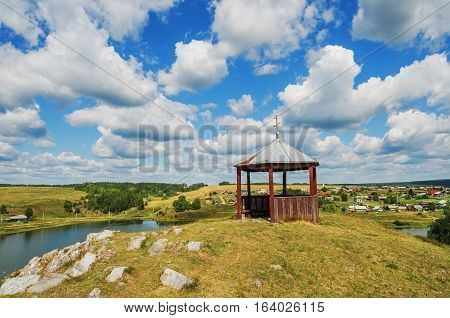 Gazebo on top of a hill in the village Chusovoe. Russia. Ural