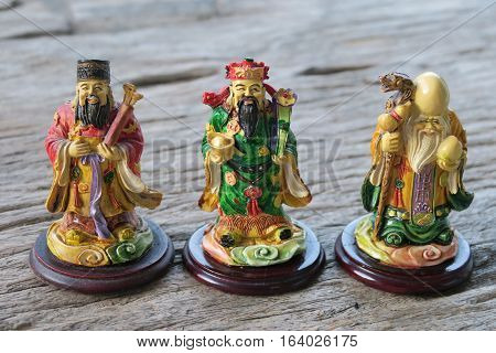 Three gods of Chinese and nature background. Hock Lok Xiu gods of Chinese on table
