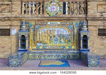 Seville, Spain - January 2, 2017: Glazed tiles bench of spanish province of Almeria at Plaza de Espana Seville Spain