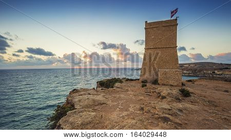 Malta - Ghajn Tuffieha watchtower at Golden Bay before sunset