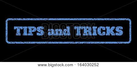 Blue rubber seal stamp with Tips and Tricks text. Vector tag inside rounded rectangular shape. Grunge design and dirty texture for watermark labels. Horisontal sign on a black background.