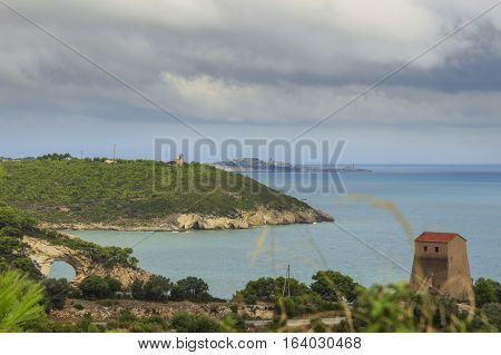 Apulia coast: panoramic view of San Felice Bay, Italy.Gargano National Park: the little rock arch (Architello) is spectacular symbol of Vieste town.