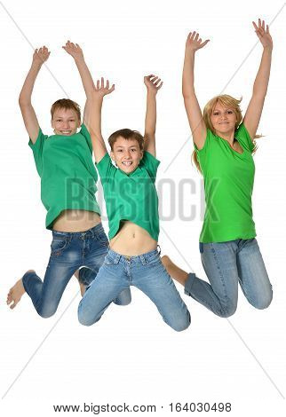 mother jumping with sons, against on white background