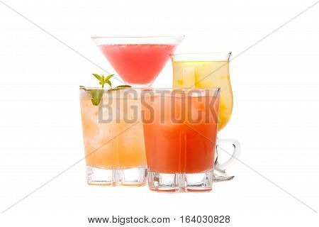 Composition of the four variants of alcoholic cocktails isolated on white background.