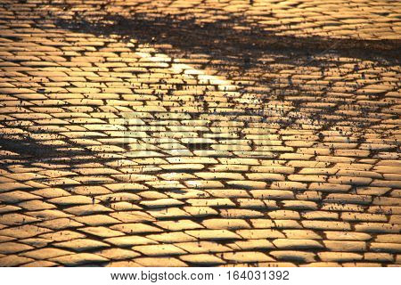Old Cobble stone street background at sunset