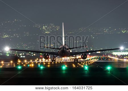 Airplane taking off from the airport in night.