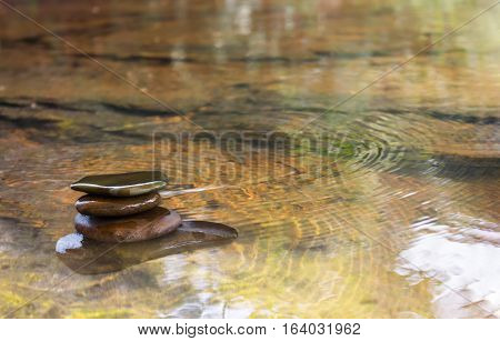 Pebble Or Balance Stone In Water Furface Nature Background