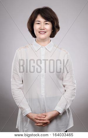 Asian middle-aged female studio portrait - isolated