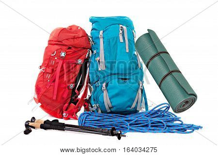 Hiking equipment rucksacks poles rope and slipping pad . Isolated on white background.