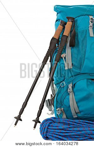 Hiking equipment rucksacks poles and rope. Isolated on white background.