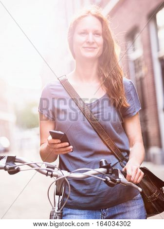 City Woman With Phone And Bicycle