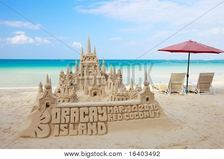Sand castle on tropical white sand beach in Boracay, Philippines