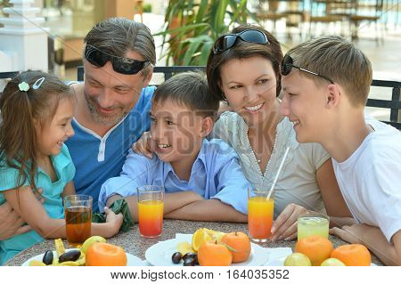big family having breakfast,  mother, father, brothers and sister