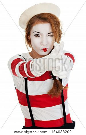 Portrait of the female MIM comedian doing gun hand gesture isolated on white background
