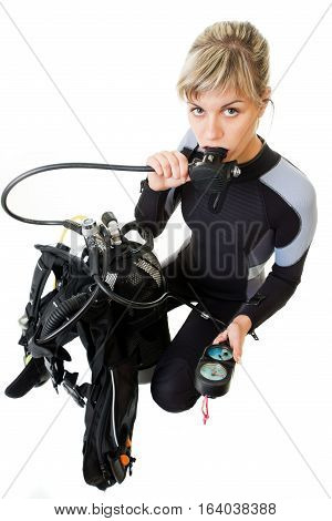 diver cheking pressure by manometer before dive. Isolated on white.
