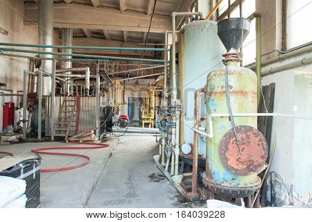 old production machine. old manufactory. fragment of the industrial machine.Inside in factory. boiler room, energy efficient production.